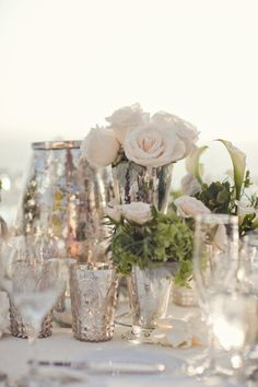 White, green and mercury glass...LOVE mercury glass with white floral arrangements and soft candle light <3