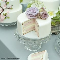 This would be a beautiful idea-several different cakes topped with various flowers - simple elegance.