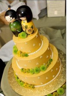 Kokeshi dolls with golden colored cake platter. | Yelp