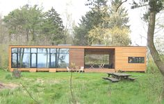 Neat modern pre-fab dogtrot style house that uses the outdoors as part of the home's livable space.