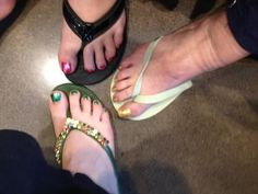TOES, TOES, TOES... What can one tell from toes? Inquiring minds want to know!  If you look at all three big toes, they are shaped very much alike. Blame it on genetics!  All three sets of nails are painted with shiny polish. Similar personalities?  Two younger gals have on flip flops, mom wearing sandals Safety first!  Two sisters shoes are touching. Heartwarming!  One didn't remove cotton! Really???