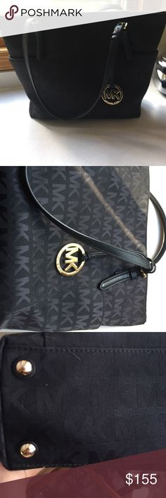 """MICHAEL KORS Jet Set Logo Tote WITH ZIPPER MICHAEL KORS Jet Set Logo Tote WITH ZIPPER; Black logo PVC. Goldtone hardware. Buckled leather straps, 9"""" drop. Logo medallion hangs on front. Outside pockets. Inside, monogram lining; one center zip compartment; one zip and four open pockets. Approx. 11""""H x 12""""W x 6""""D. Imported. THE BAG IS IN GREAT CONDITION. NO TRADES! Michael Kors Bags"""