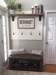 Front Entryway Hall Tree Bench with Shiplap Wall and Shelf. We hand-painted the family name sign to give this entry feature a personal touch.