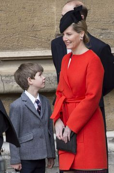 Sophie's youngest child James looked dapper in a gray blazer, shirt and tie as he smiled at his mother outside the church