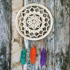 Crochet dream catcher with crochet feathers are by Laura_Makes