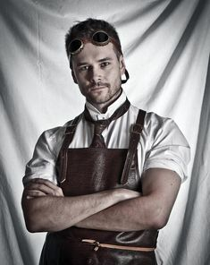 Steampunk guy with goggles and leather workman's apron