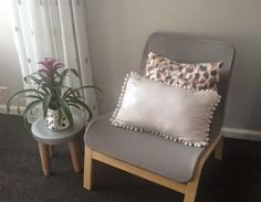 Baby nursery, nursing chair IKEA, envelope cushions, Resene paints, charcoal carpet