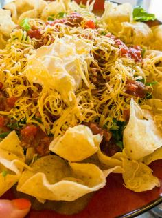 Recipe for Deli Style Taco Salad - The chili is cooked in the crockpot and the rest of the taco salad just takes a few minutes to create so it's pretty easy!