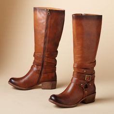 "TYLER EQUESTRIAN BOOTS -- Kork-Ease® puts the classic riding boot in a new light, wrapping the tall, Tuscan-tanned vachetta leather shaft with a spiraling buckled harness strap. Imported. Stoutly soled, with a 1-1/2"" block heel. Whole and half sizes 6 to 10, 11. View our entire Kork-Ease Collection."
