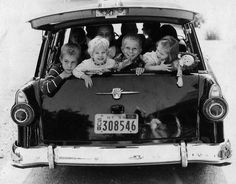 No seat belts or car seats, 1955/56 ... boy, there are a lot of kids in that car and they look like they're having a blast.  :)