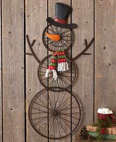 "The design of this 36"" Hanging Bicycle Wheel Snowman was inspired by old-school wire bike wheels. Created with the antique-lover in mind, this piece is designed to hang"