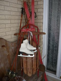 Decorating the ski cabin front porch with Ice Skates, sleds and vintage skis - sooo cute