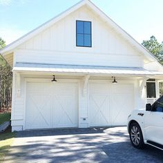 """If we are to do a """"trellis"""" type of design over the barn door on the side or even on the garage side, I think it needs to be like this with the metal roof material on top. Love our barn lights from {custom carriage style garage doors} Plan Garage, Garage Exterior, Garage Ideas, Diy Garage, Garage Bathroom, Detached Garage Plans, Carport Garage, Garage Workbench, Garage Walls"""