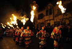 "Bulgarian ""Kukeri"" dancers carry torches during a carnival in the village of Gabrovdol. The Kukeri Carnival marks the beginning of spring, Masks are intended to drive away sickness and evil spirits."