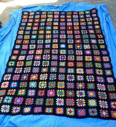 A granny square blanket made by Beth and Polly - great story behind this #crochet project