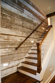 Reclaimed wood wall treatment | With more than one gabled roof and a long, wrap-around columned porch, from far away, this Iowa City farmhouse looks like it was built a…