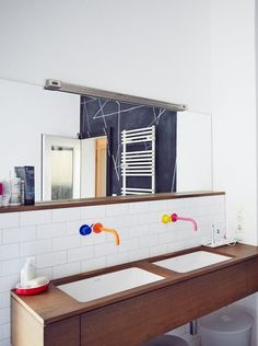 Unique Ways to Add Color to a Renovated Bathroom | One of my favorite trends recently is the re-introduction of color to the bathroom. After so many years of white and beige, it's about time. If you'd like to take baby steps, you can introduce color to your bathroom with art, or with paint, or maybe even with some nice towels — but if you're ready to really commit, consider one of these unexpected (and unexpectedly delightful) ways to add color to your bathroom.