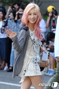 She's so cute with pink hair I'm surprised she let them dye it that color