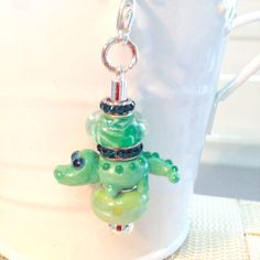 Unique Zipper Pull made with Glass European Charm Beads! A cute alligator surrounded by a glass and ceramic bead!  Add a little glitz to anything with a zipper......your jacket, sweater, purse, cosmetic bag, gym bag, lunch bag, travel bags, etc.  Kids love these for their backpacks
