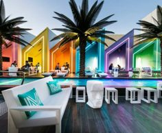 Colourful booths beside a pool