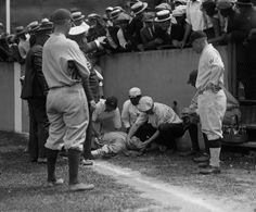 Babe Ruth lying unconscious after running into a wall chasing a fly ball. He would regain consciousness 5 minutes later and get 2 more hits in the game. July 5, 1924