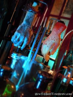 Mad Scientist Lab I recognize the item the hands are haning from!!  Good to know if I cannot get one of my bottle racks' dispensers to work....