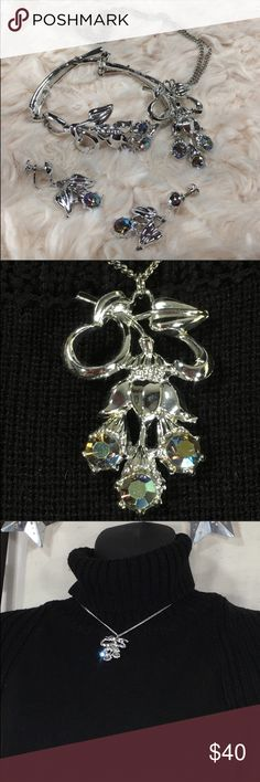 """Vintage S&G 5th Avenue AB Rhinestone Set Vintage S&G 5th Avenue AB Rhinestone Jewelry set : necklace, bracelet and screw-back earrings.   Bracelet measures 6.5"""" long; earrings have a 1.25"""" drop; necklace chain is 15"""" long and pendant is 2"""" x 1.25"""".   Pre-owned Vintage: Minor scratches and scruffs from gentle wear. This set is a beauty and highly coveted. 😍 Vintage Jewelry"""