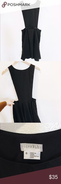 Black Pinafore Dress Cooperative pinafore dress with buttons and flared bottom. Like new. Cooperative Dresses Mini