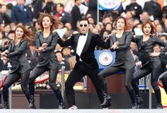 Singer Psy (C) performs during the inauguration ceremony of South Korea's new President Park Geun-Hye at parliament in Seoul. (Kim Hong-Ji/Getty Images)
