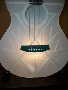 Have you ever wondered if a working guitar could be 3D printed? That question has now been answered by Jeff Kerr's beautifuly printed model.  Not only does