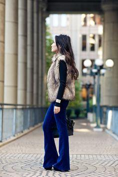 Blue velvet pants and a fur vest. Beautiful blend of textures.