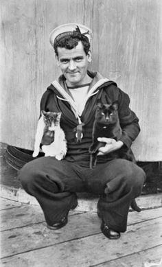Sailor on board the HMAS Melbourne holding two ship's cats, 1917 (WWI)