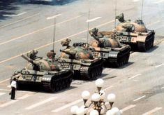 """Tiananmen Square 'Tank Man', 1989. Dragged away, the identity of this man and his fate remains unknown.  But to me he is the """"face"""" of courage."""