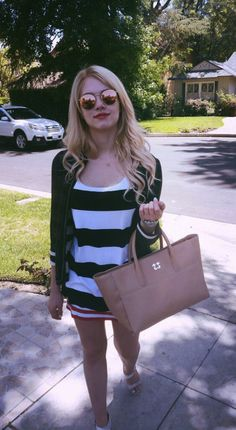 Actress Claudia Lee carrying the Sheena Sujan Barclay tote in brown.