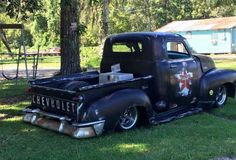 Advanced Design Chevy Pickup with a shorty bed, custom rear bumper, custom tail lights, and a fauxtina paint job