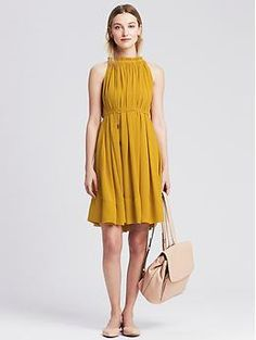 Pleated Halter Dress   Banana Republic. not sure about the color but it is interesting. I like the cut of the top part- seems very flattering