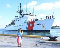 A little girl in a patriotic skirt waves goodbye to a parent and other crew members of the U.S. Coast Guard Cutter Thetis, as they get underway for inclement weather ahead of Tropical Storm Elsa in Key West, Florida. Patriotic Poems, Coast Guard Cutter, Waves Goodbye, Key West, Little Girls, Parenting, Tropical, United States, West Florida