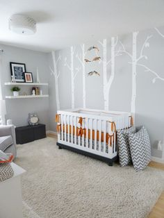 There are so many sweet and lovely things to like about this nursery. The colors, the integration of birds on branches mobile with the mural of trees, the birdhouse nightlight... Enchanting.
