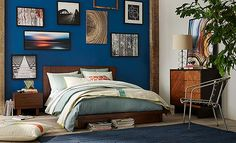 I love the West Elm Natural Nomad Bedroom on westelm.com/ - love this blue wall and mix of contemporary and natural materials