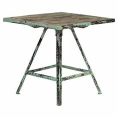 "Add rustic appeal to your home library or living room with this eye-catching side table, crafted from iron and showcasing a distressed green and brown finish.  Product: Side tableConstruction Material: IronColor: Green and brownFeatures: Distressed finishDimensions: 21.5"" H x 22"" W x 22"" D"