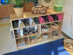 DVD cases, loose parts in the construction play area - Peachtree Presbyterian Preschol ≈≈: