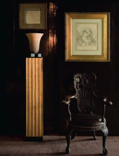 """""""In the corridor leading to the library, a bright column of Ernest Boiceau terracotta and chair of English origin surmounted by a delicat..."""
