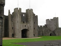 Pembroke Castle, Wales  Me and Ed used to go here about once a month and run through it!! Fun
