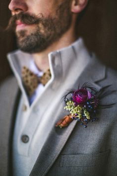 feathered boutonniere, photo by The Willinghams http://ruffledblog.com/feathers-and-wood-wedding-inspiration #weddingideas #boutonnieres