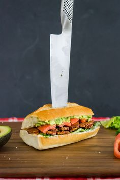 Crispy maple tempeh bacon, cashew ranch dressing, and mashed avocado complete this incredible sandwich.