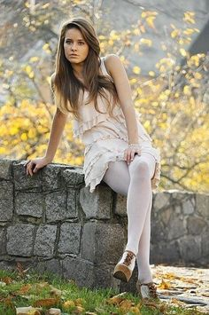 White dress with white tights and heels.