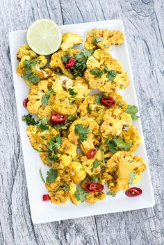 Healthy, oven-baked Turmeric Roasted Cauliflower Recipe made with olive oil, garlic, garam masala and turmeric for a Indian curry flavor that is delicious! Best Vegan Recipes, Easy Healthy Recipes, Whole Food Recipes, Healthy Snacks, Vegetarian Recipes, Family Recipes, Vegan Lunches, Roasted Cauliflower Steaks, Vegan Cauliflower
