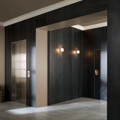 Interior with Urbatek XLight Concrete dark concrete look ceramic tiles. Architect unknown.