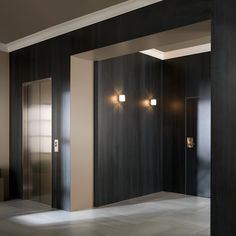 Interior with Urbatek XLight Concrete dark concrete look ceramic tiles.  Architect unknown.
