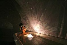 Cool planetarium floating light for your bath tub. It's a lot less of a fire hazard then those scented candles too.